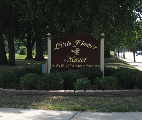 Little Flower Manor Brown Sign